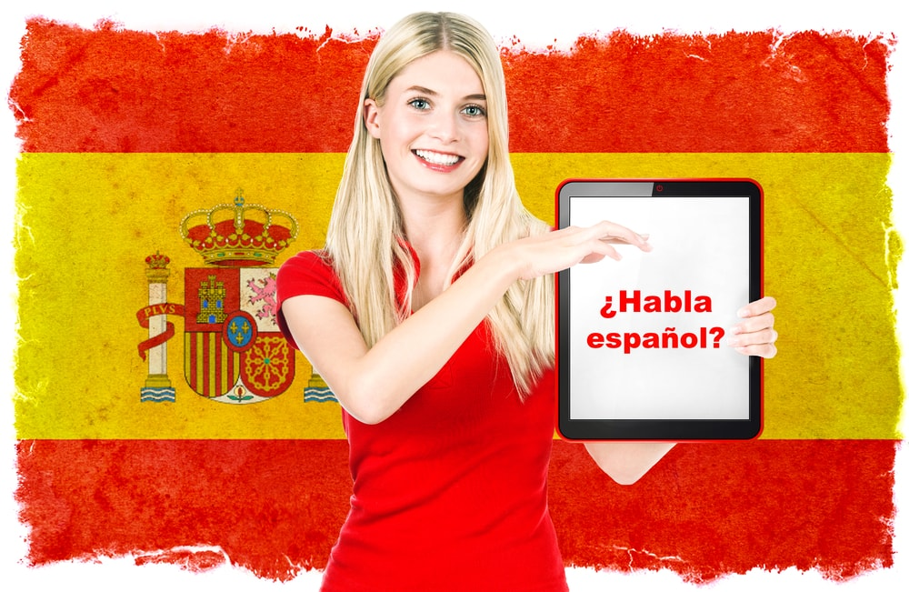 Girl Holding Spanish Sign