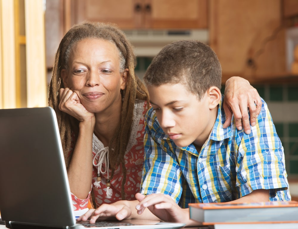 Mother And Son Using Computer