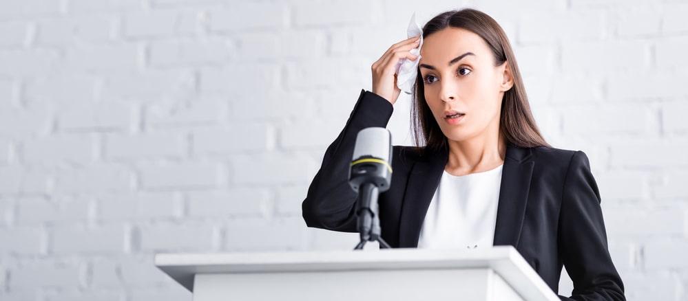 Nervous woman giving speech
